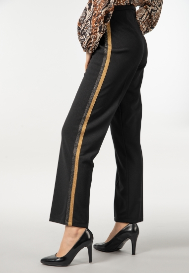 Damskie spodnie materiałowe...